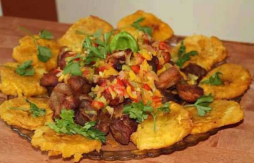 Grio, fried plantain, and pikliz (center)